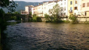 Morning sun on the river-side houses in Quillan from across the Aude