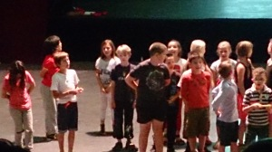 Tomos singing with classmates
